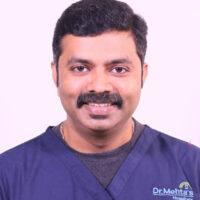 Dr Dhenesh